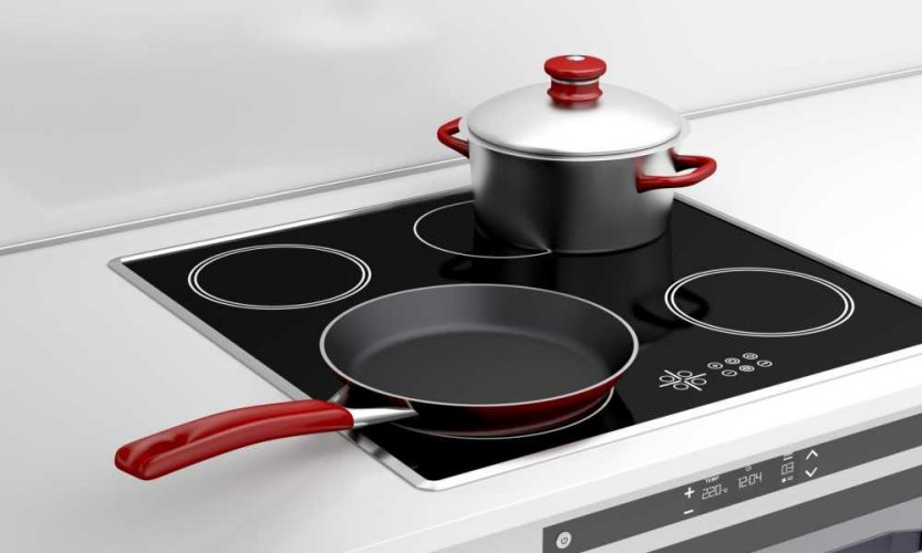pot and frying pan on built-in induction cooktop