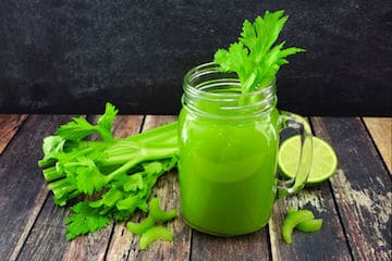 Celery juice in a mason jar glass.