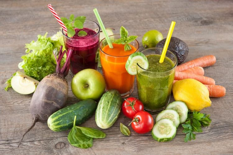 Various fruit and vegetable with beet carrot and green juice