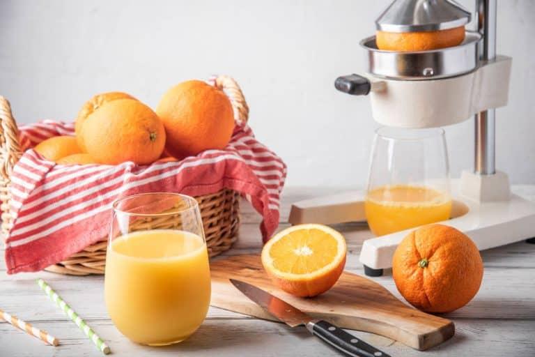 citrus juicer with fresh squeezed orange juice