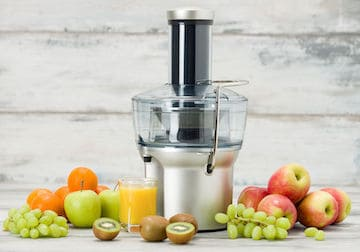 Centrifugal juicer with apples, grapes, oranges, kiwi