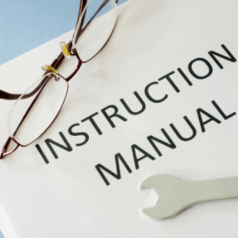 instruction manual with glasses and wrench