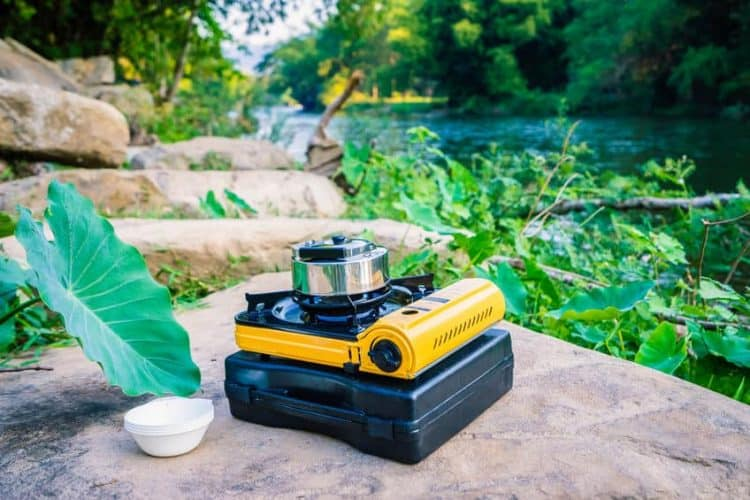 portable butane gas stove with aluminum teapot for boiling water