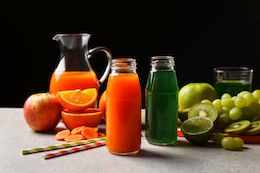 carrot and green juices and fruits