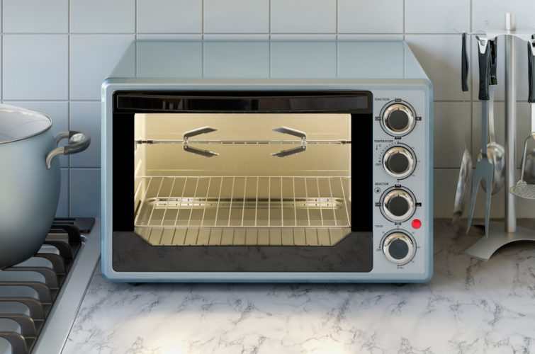 Convection toaster oven on the kitchen table. 3D rendering