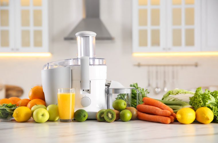 juicer with fruits and vegetables